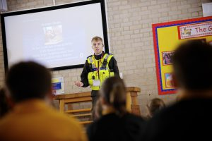 PCSO Jack Evans speaking to youngsters about stranger danger.